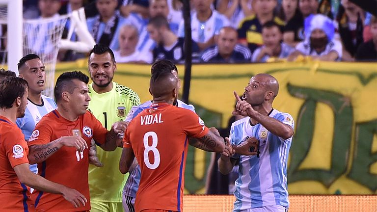 An ill-tempered match saw eight yellow cards - including for Argentina's Javier Mascherano (R) and Chile's Arturo Vidal - as well as two reds
