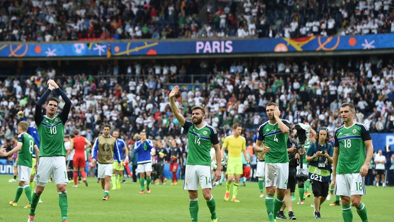 Northern Ireland players wave to the crowd after securing qualification