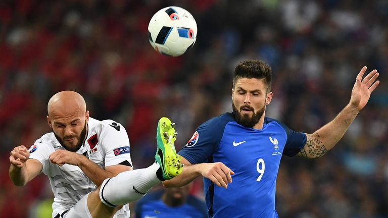 Albania defender Arlind Ajeti  (L) vies for the ball against Olivier Giroud