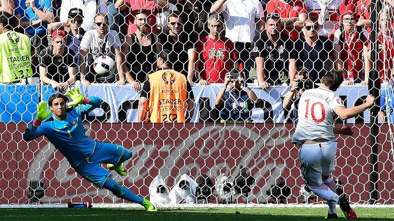 Poland's midfielder Krychowiak (R) scores his penalty against Switzerland