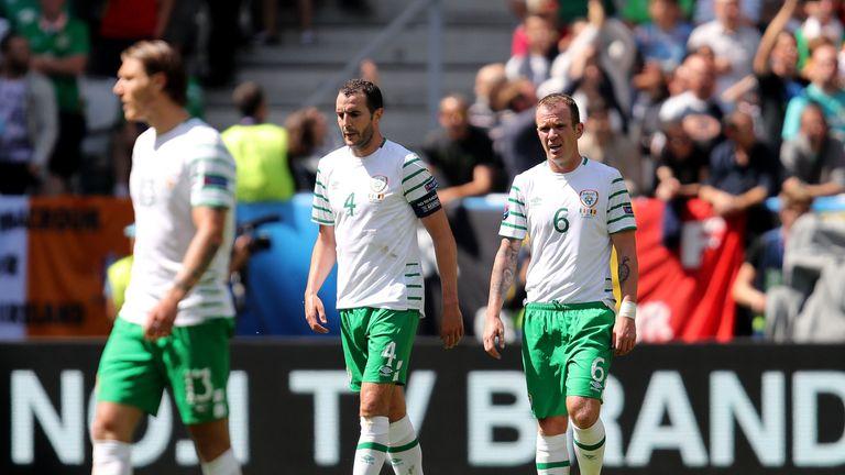 Republic of Ireland's John O'Shea and Glenn Whelan appear dejected