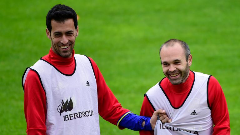 Spain midfielders Sergio Busquets (l) and Andres Iniesta (r) share a joke