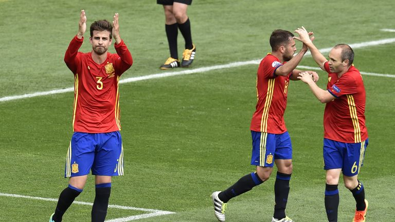 Spain's current style relies more on the centre-backs such as Gerard Pique (left) to begin attacks