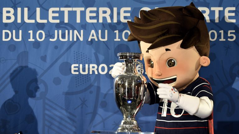 Euro 2016 mascot Super Victor with the Henri Delaunay trophy