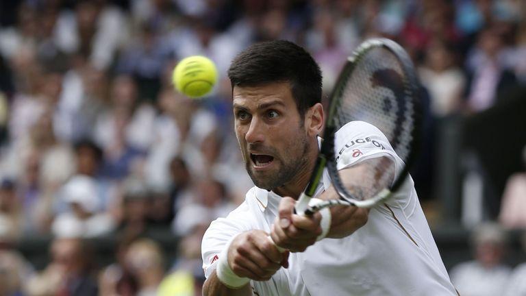 Novak Djokovic beat Britain's James Ward to reach the second round at Wimbledon