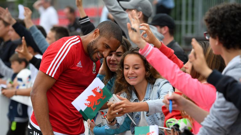 Wales captain Ashley Williams poses for pictures with local children