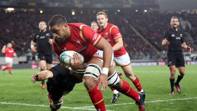 Sam Cane attempts to tackle Wales' Taulupe Faletau as he heads for a try