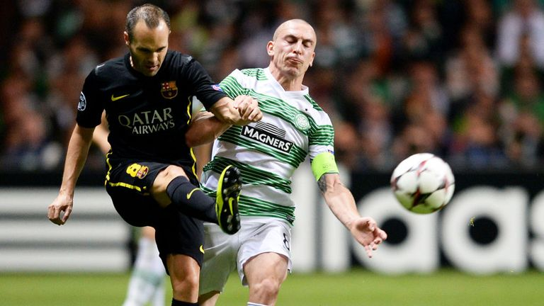 Brown challenges Andrea Iniesta of Barcelona in a Champions League match in 2013