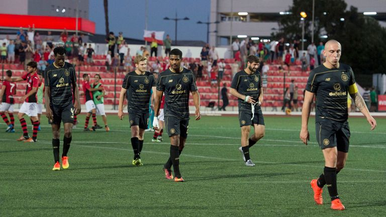 Celtic players leave the field after their shock defeat in Gibraltar