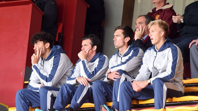 Joey Barton (2nd left) will not be part of Mark Warburton's matchday squad