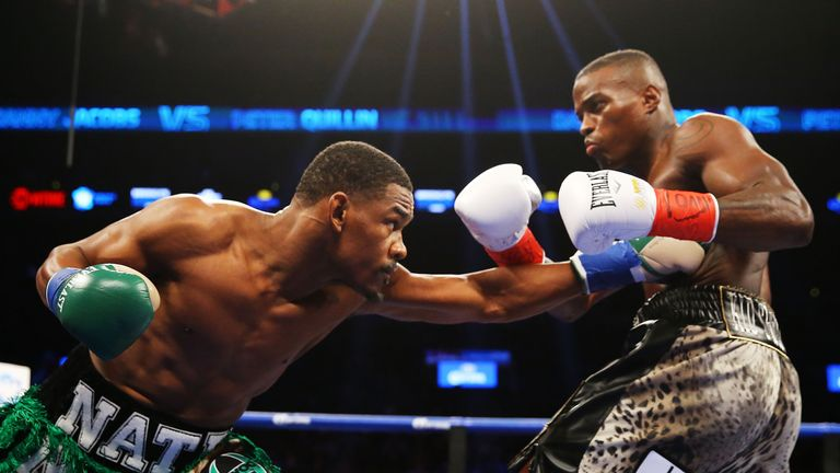 Danny Jacobs (left) punches Peter Quillin during their WBA middleweight championship bout