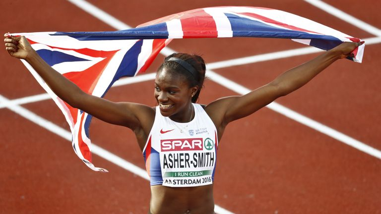 Dina Asher-Smith celebrates after winning gold at the European Championships