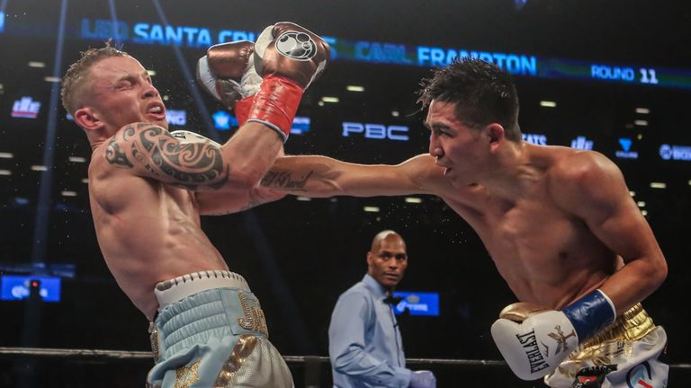 Leo Santa Cruz of Mexico (gold trunks) fights Carl Frampton of Northern Ireland (blue trunks)