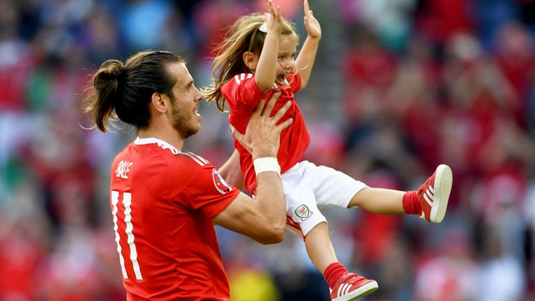 Gareth Bale celebrates with his daughter after Wales beat Northern Ireland