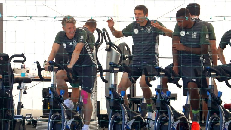 (L-R) Schweinsteiger, Thomas Muller and Jerome Boateng of Germany warm up on bikes before training