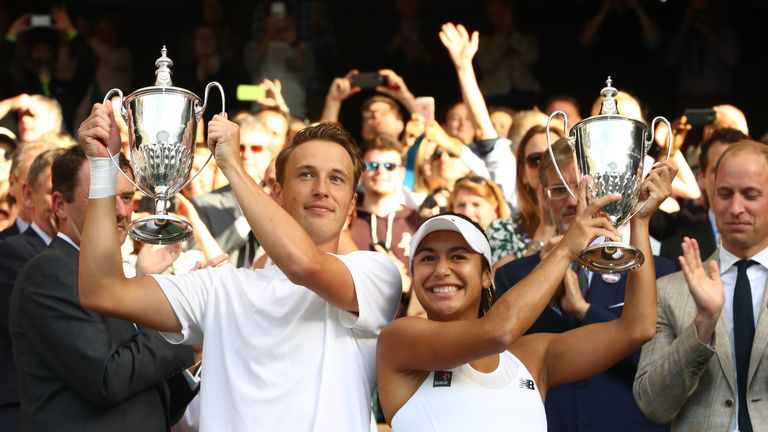 Heather Watson celebrates victory in the mixed doubles final with Henri Kontinen