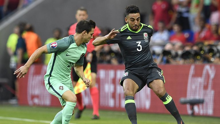 Neil Taylor (right) looks to get the better of Cedric Soares (left)