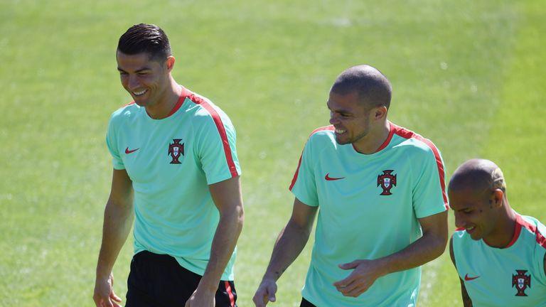 Ronaldo and Pepe share a joke in training