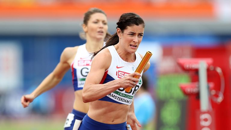 Seren Bundy-Davies takes the baton from Kelly Massey during the 4x400m qualifying heat