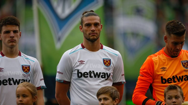 367d802ab Andy Carroll wears the new West Ham away kit with Adrian sporting the goalkeeper s  jersey in
