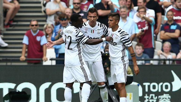 Mario Mandzukic (middle) celebrates goal for Juventus