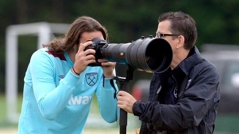 West Ham striker Carroll turns cameraman at training