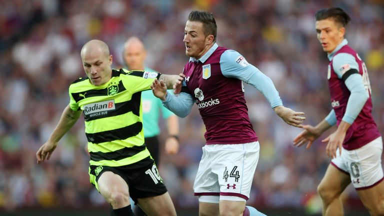 Aston Villa's Ross McCormack and Huddersfield Town's Aaron Mooy battle for the ball