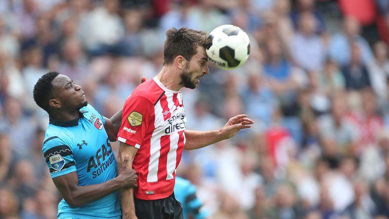 PSV's Davy Propper wins a header against AZ Alkmaar