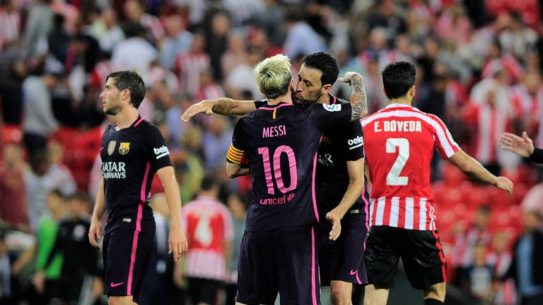 Barcelona's Lionel Messi and Sergio Busquets celebrate their 1-0 victory