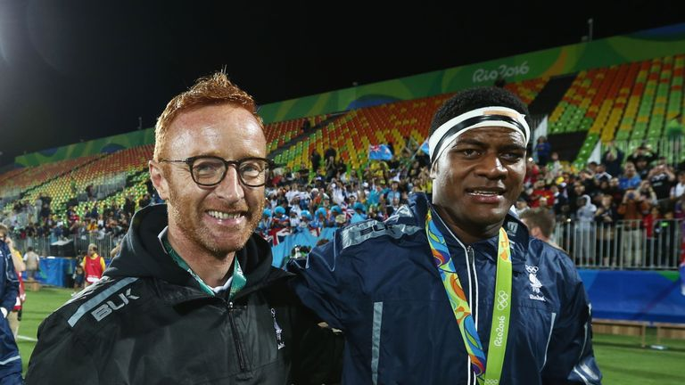 Fiji head coach Ben Ryan (R) celebrates with  Ro Dakuwaqa after the medal ceremony