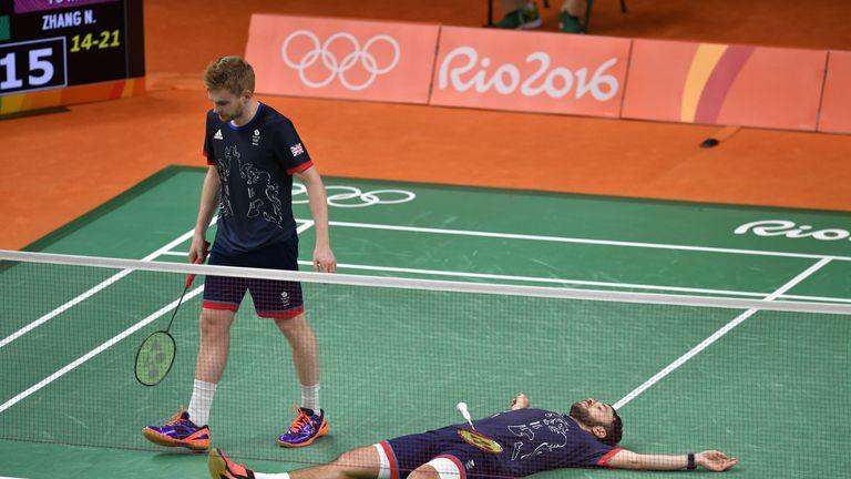 Langridge lies flat on his back as he completes a famous victory alongside Ellis