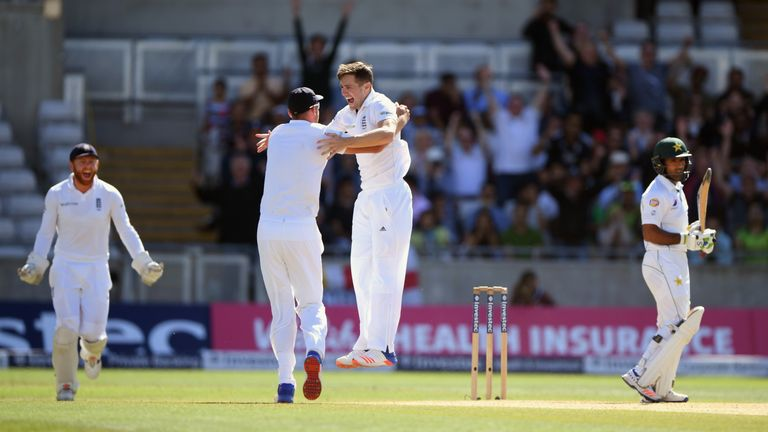 Chris Woakes celebrates with Stuart Broad after dismissing Asad Shafiq
