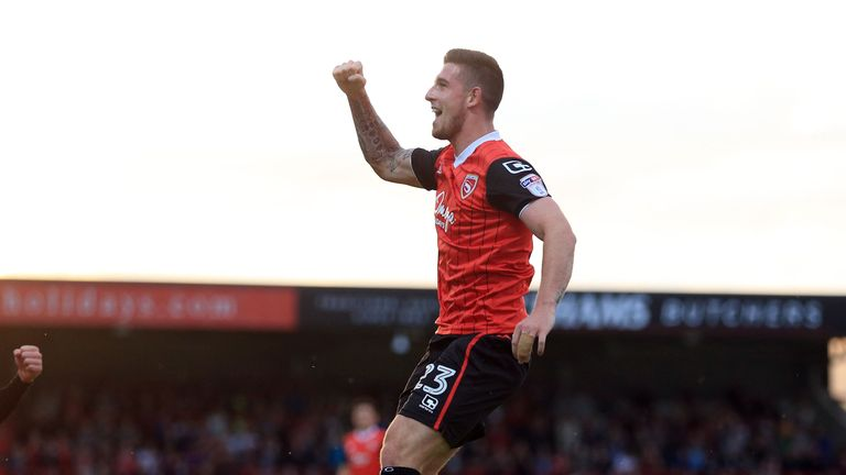 Morecambe's Cole Stockton celebrates after scoring but it proved in vain