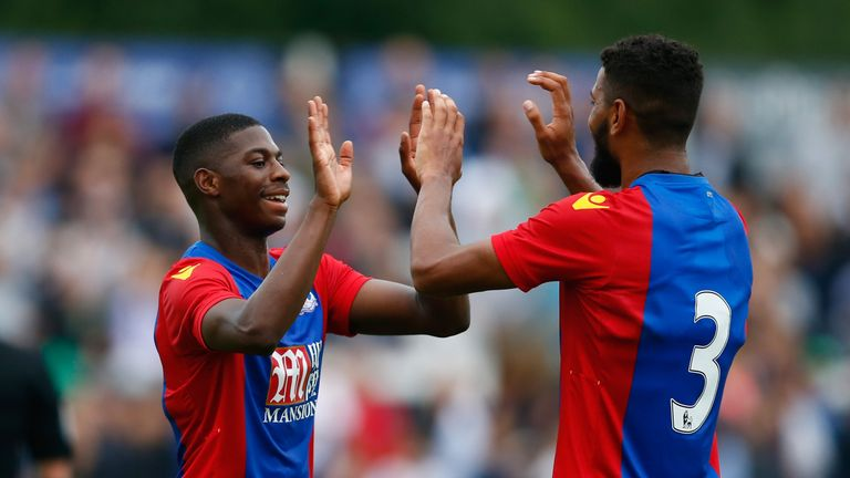 Crystal Palace's Sullay Kaikai (L) is congratulated after opening the scoring at Bromley