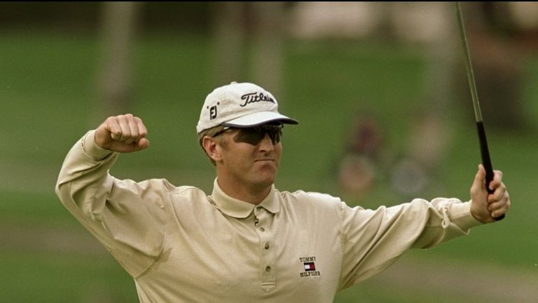 David Duval celebrates after holing his eagle putt for a 59 in California