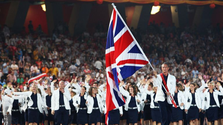 Mark Foster of the Great Britain Olympic men's swim team carries his country's flag at Beijing 2008
