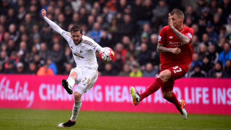 Sigurdsson gets in a shot at goal in last season's game against Liverpool