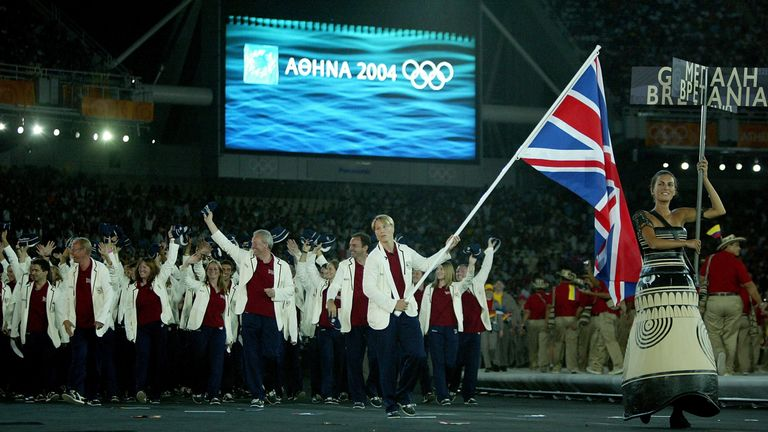 Flag bearer Kate Howey leads the delegation from Great Britain as they walk during the parade of nations at the 2004 Athens Olympics opening ceremony