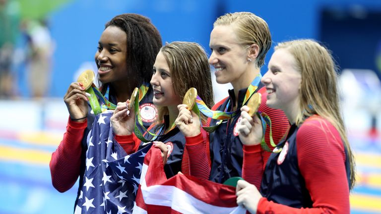 Simone Manuel (L) anchored the USA to 4x100m medley relay glory - a landmark medal