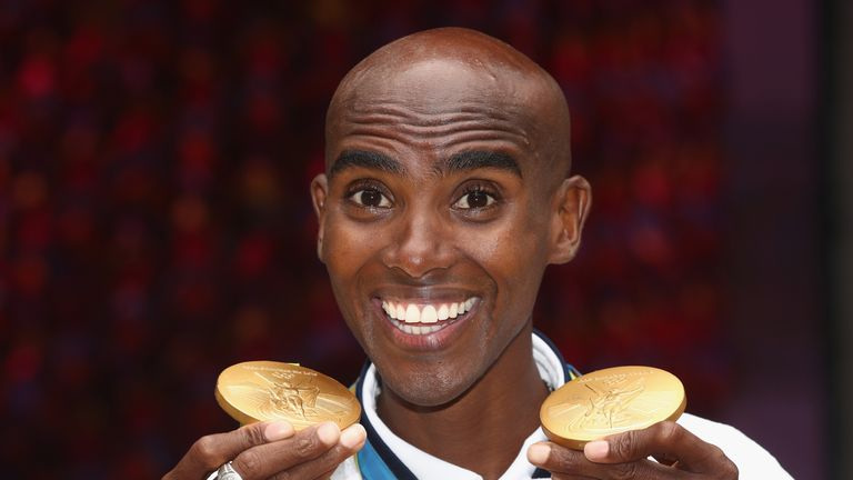 Farah shows off his two gold medals from Rio