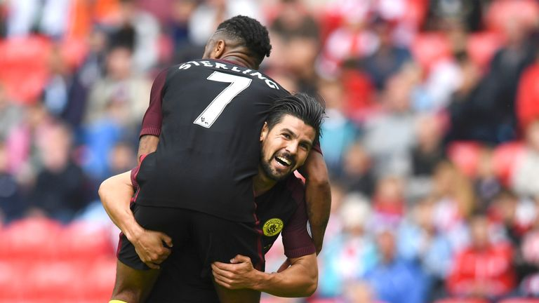 Nolito (R) celebrates his goal with team-mate Raheem Sterling