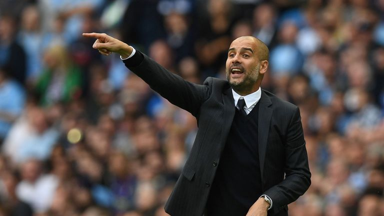 Pep Guardiola gestures during his first competitive match as City head coach