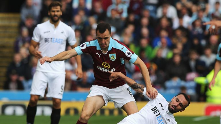 Dean Marney of Burnley battles for possession with Leon Britton of Swansea City