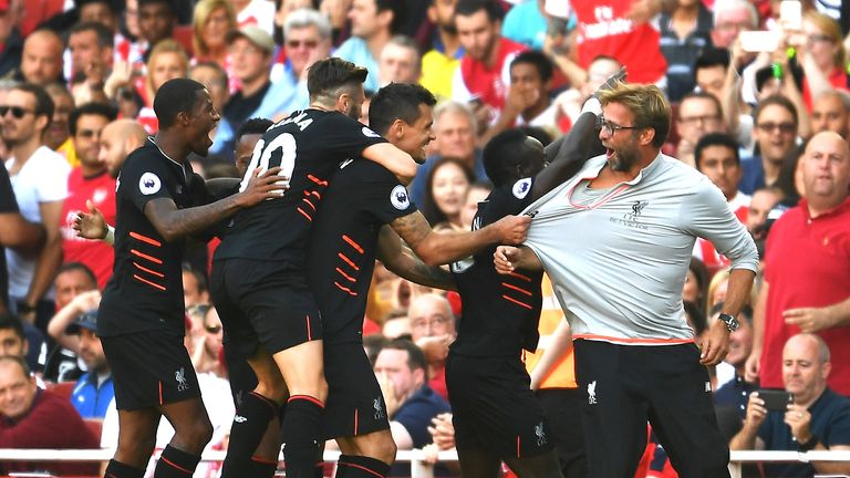 Liverpool players celebrate with Klopp