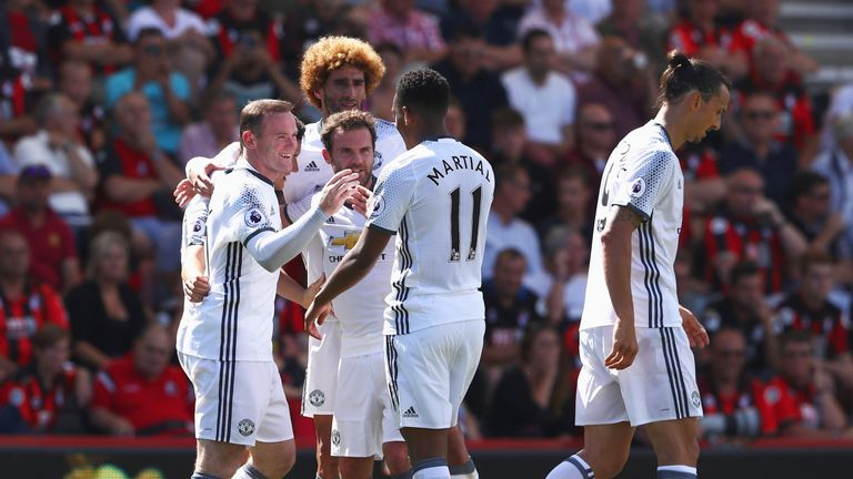 Wayne Rooney celebrates after scoring United's second goal at the Vitality Stadium