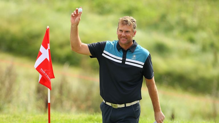 Robert Karlsson celebrates his hole in one at the 16th