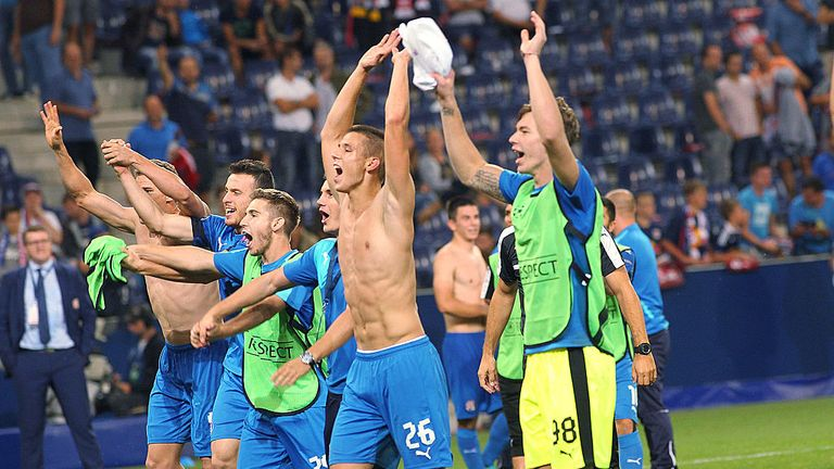 Dinamo Zagreb's players celebrate after beating Red Bull Salzburg