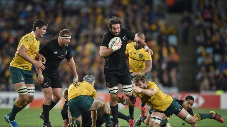 Sam Whitelock of New Zealand carries against Australia