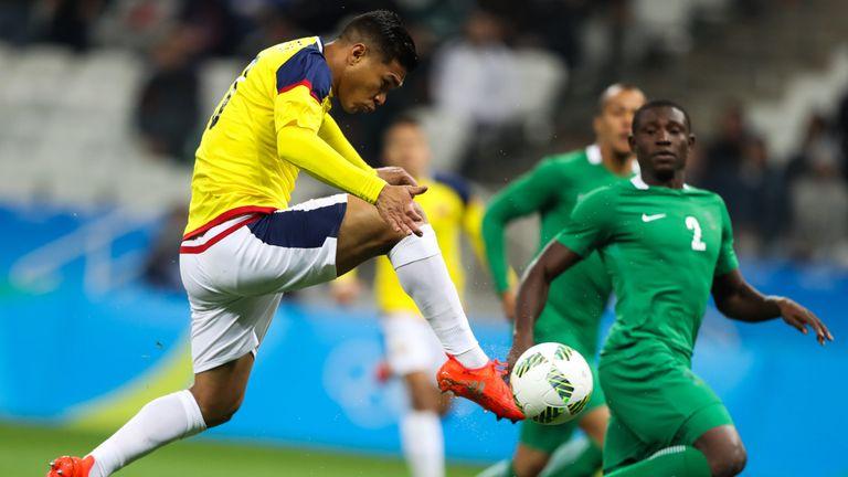 Teofilo Gutierrez volleys home Colombia's opener against Nigeria