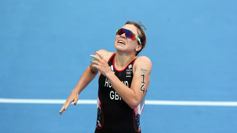 Holland crosses the triathlon finishing line in third place for Team GB